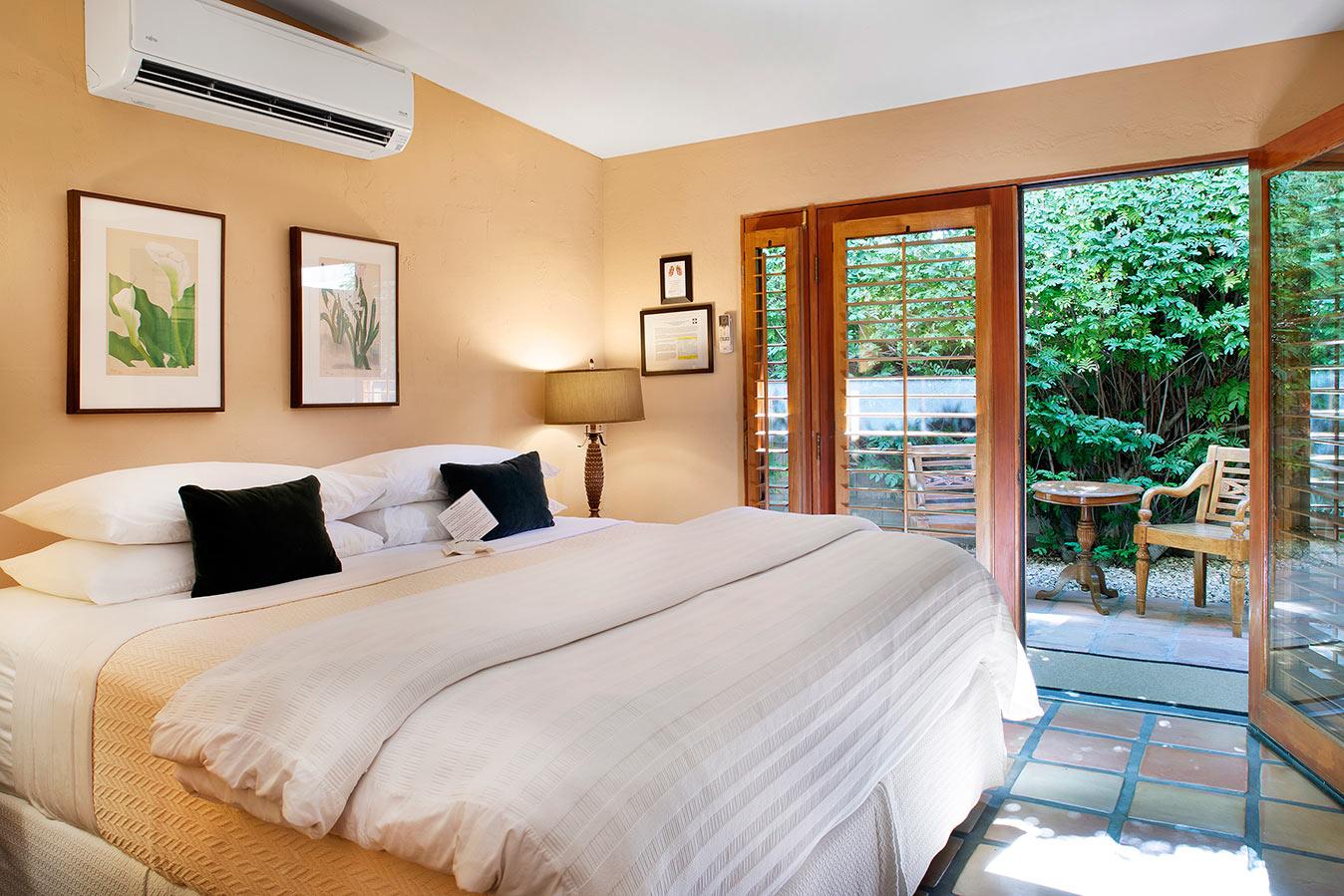 Patio Room Bedroom at The Hacienda in Gay Palm Springs