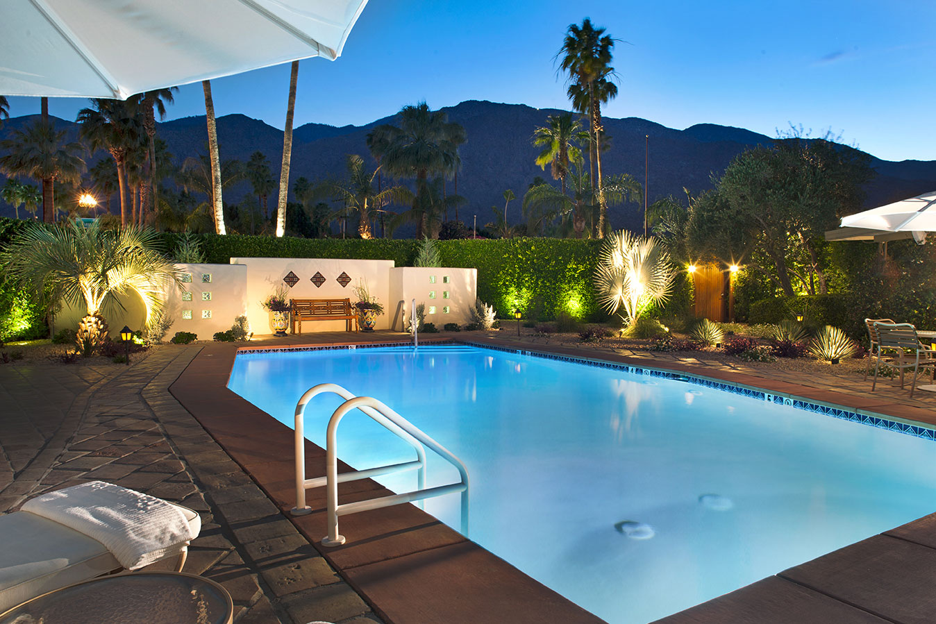 Sunset pool view at The Hacienda in Gay Palm Springs